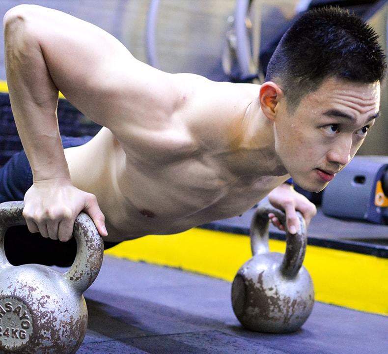 Fitness Coach Richard Liao doing push ups for circuit training programs