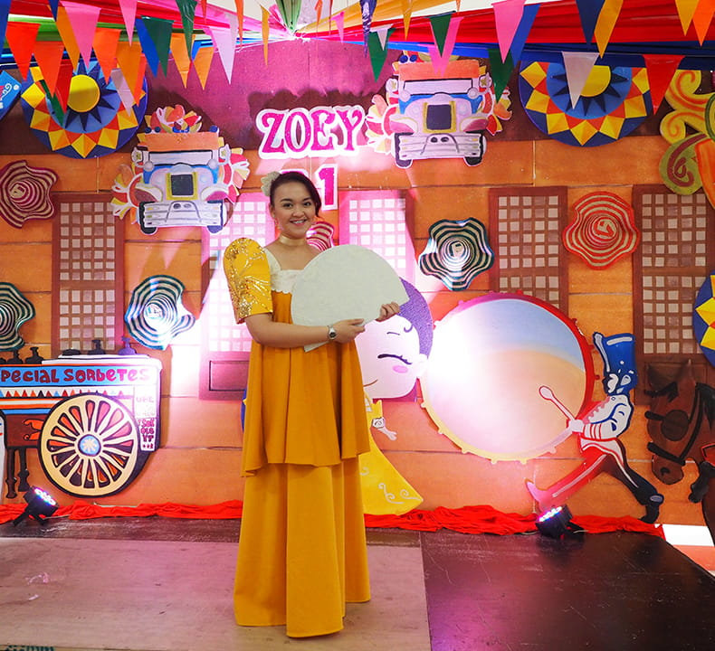 Make Believe Productions Playdates performer on a filipinana