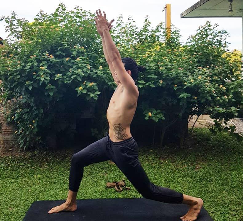Professional yogi Joshua Webb warming up before flow yoga