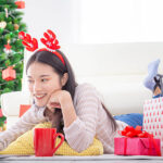 Woman looking for virtual christmas party ideas