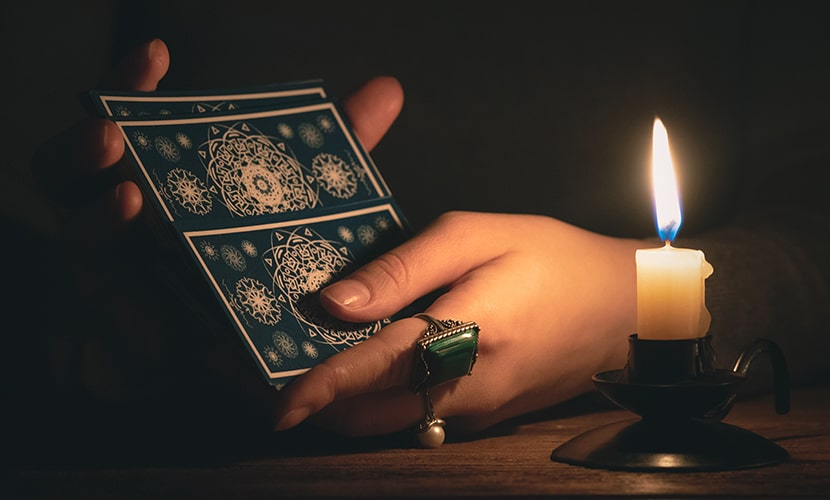 Tarot cards and a candle