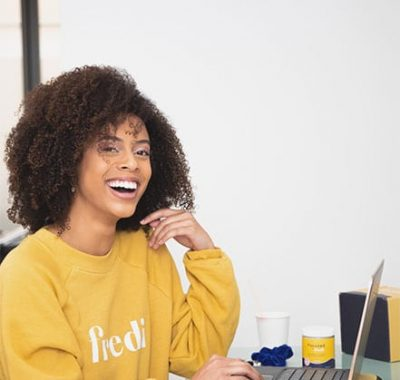 Woman enjoys virtual team building activities